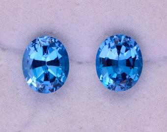 Stunning Swiss Blue Topaz Gemstone Match Pair, 9.78 tcw., 11x9 mm., Oval Shapes