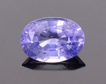 Unique Blue Sapphire Gemstone with Negative Crystal Inclusions, 1.25 cts., 7x5 mm., Oval Shape.