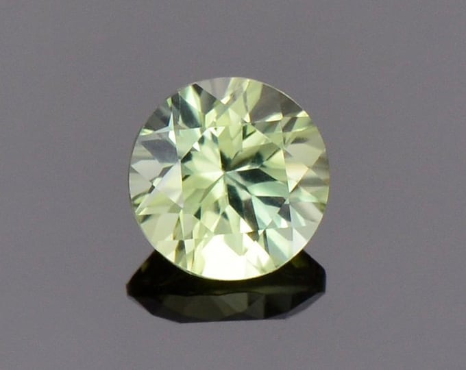 Bright Yellow Green Sapphire from Australia, 0.50 cts., 5 mm., Round Brilliant Cut