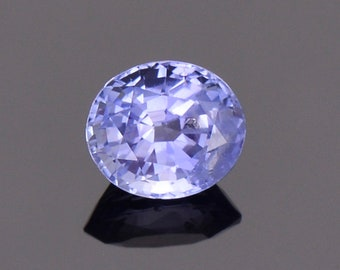 Fascinating Blue Sapphire Gemstone with Negative Crystal Inclusion, 1.51 cts., 7 x 6 mm., Oval Shape