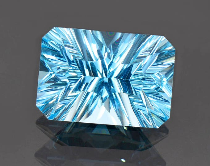 Large Electric Blue Topaz Gemstone from Brazil, 14.97 cts., 17x12mm., Concave Emerald Cut.