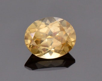 Lovely Yellow Scheelite Gemstone from China, 2.64 cts., 7.9 x 6.4 mm., Oval Cut