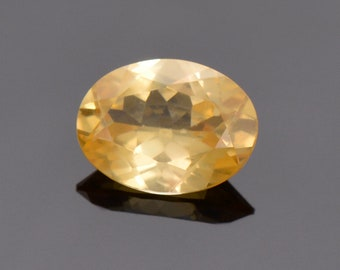 Beautiful Bright Yellow Scheelite Gemstone from China, 3.31 cts., 9x7 mm., Oval Cut