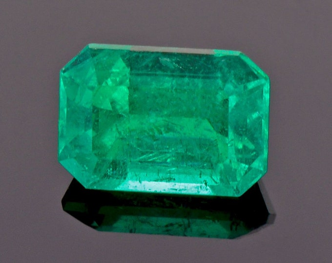 Featured listing image: Exquisite Neon Green Emerald Gemstone from Colombia, 2.15 cts., 9 x 6 mm., Step Emerald Cut