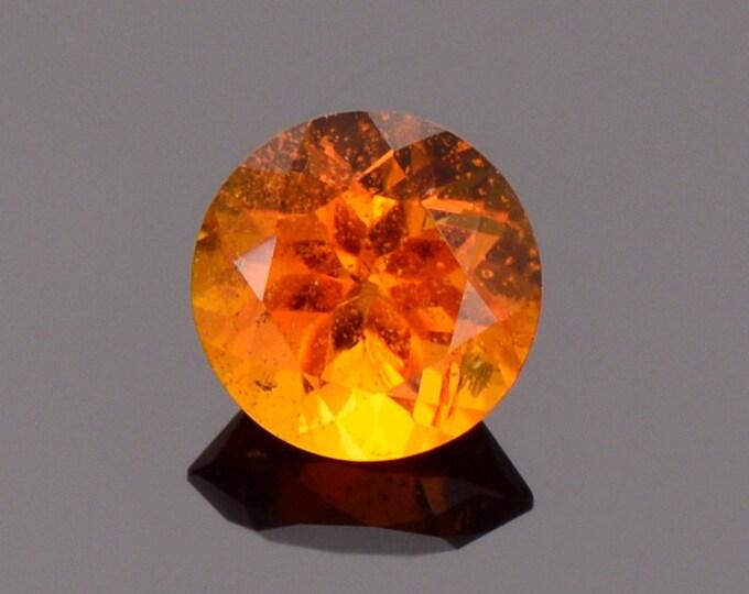 Rare Bright Orange Clinohumite Gemstone from Tajikistan, 0.68 cts., 5.50 mm., Round Cut