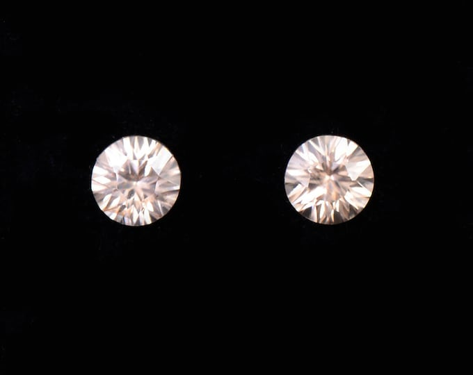 Beautiful Silvery Champagne Zircon Gemstone Pair, Concave Round Cut, 1.96 tcw., 5.5 mm.