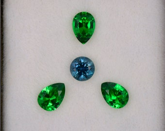 Spectacular Green Tsavorite Garnet and Blue Montana Sapphire Set, 1.89 tcw., Pear and Round Shape.