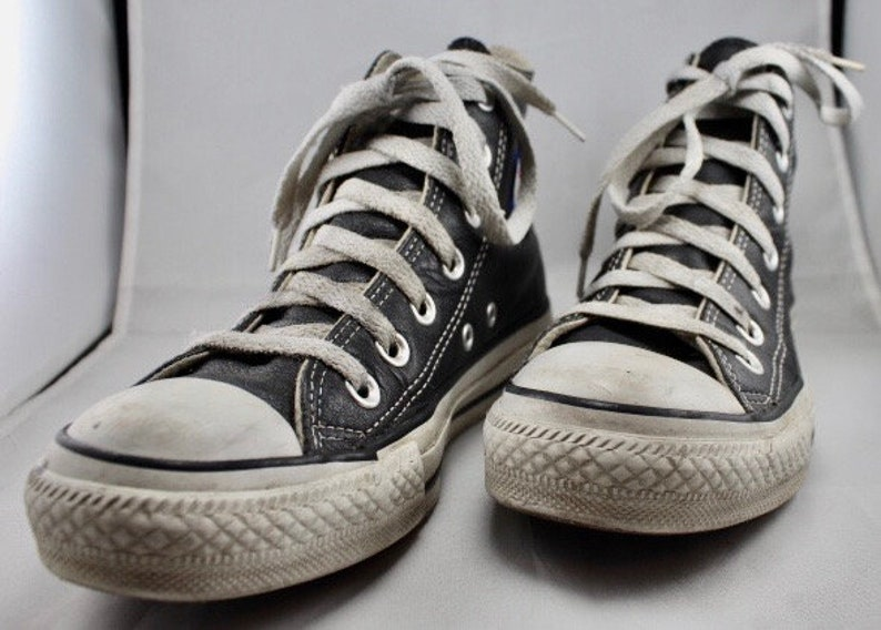 8d2ad62a546772 Black Leather Chuck Taylor All Star Shoes High Top Size 4US