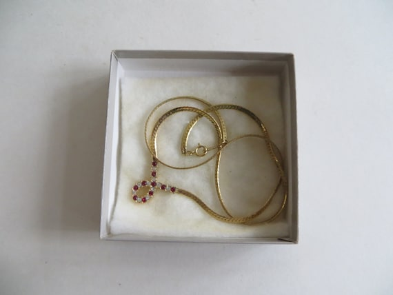 Avon Plaza Collection Red Simulated Ruby and Rhinestone Necklace Bracelet and Earrings In Original Boxes