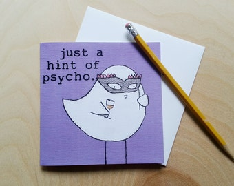 """CARD: """"Just a Hint of Psycho"""" featuring a bird with a carnival mask and a glass of wine"""