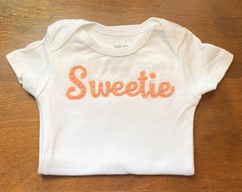 Custom embroidered onesie with word/name with felt background, Newborn to 24 month sizing, personalized baby gift for baby shower. Sweetie