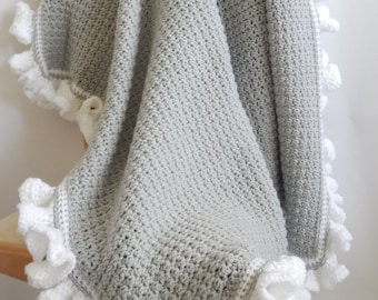 The Lauren Crocheted Blanket grey with white ruffle edging, baby crocheted blanket