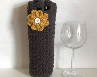 Charcoal colored crocheted wine holder with crochet flower and button accent / crochet flower / housewarming gift / thanksgiving host gift