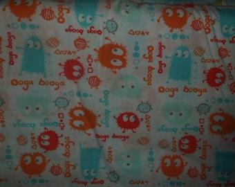 Orange Guppies Ooga Booga Cotton Sheeting Fabric by the yard