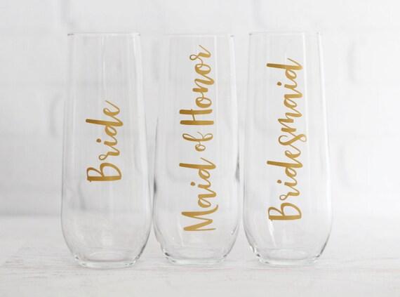 bridesmaid champagne flutes // bridal party champagne glasses // wedding champagne flutes // bridesmaid proposal // bachelorette party favor