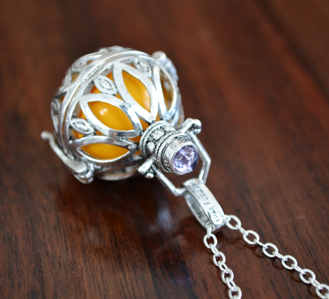 collier de grossesse bola vente jaune carillon boule. Black Bedroom Furniture Sets. Home Design Ideas