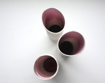 Decorative thin tall tube made out of stoneware English fine bone china and resin