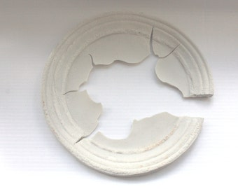 Round  frame from Royal porcelain in a pale ivory color with an aged look.