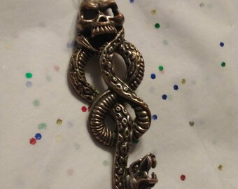Antique skull and snake necklace charm. Gothic