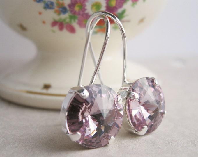 Light Purple or Lavender Rhinestone earrings in Silver plated settings.  Swarovski crystals.  Nickel free.