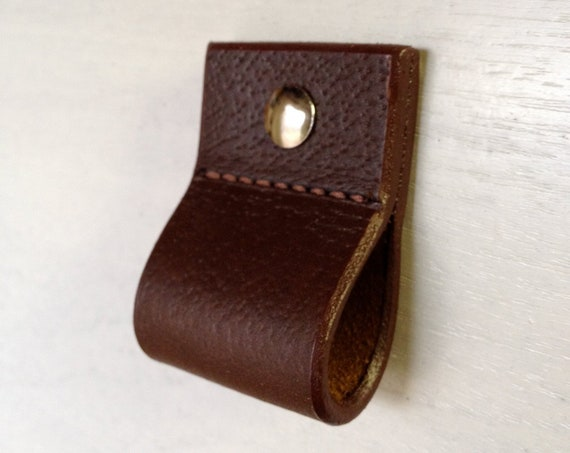 Leather drawer pull for furniture, cabinets, cases, boxes, etc.  Hand crafted from salvaged leather remnants.