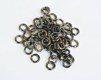 50 open black 5mm brass rings