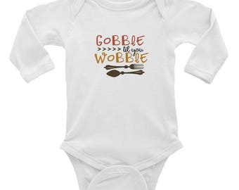 e02c303f2 Gobble til you wobble thanksgiving turkey Infant Long Sleeve Bodysuit