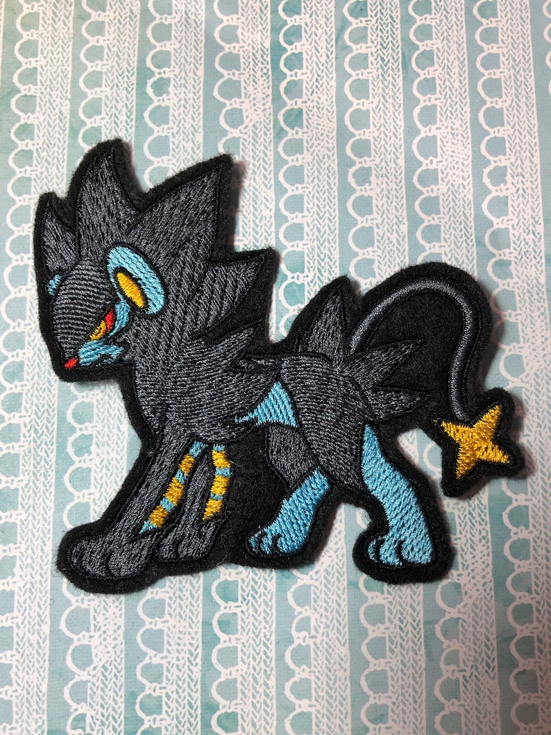 Pokemon Luxray inspired 4 lion iron-on patch