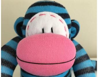 Bright and cheerful Stripy  Sock Monkey