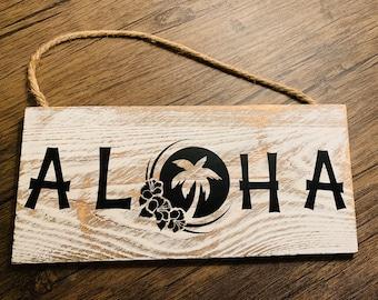 Aloha sign on white washed wood