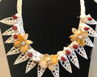 Shell necklace with orange shells and red seeds