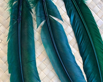 3 green feathers