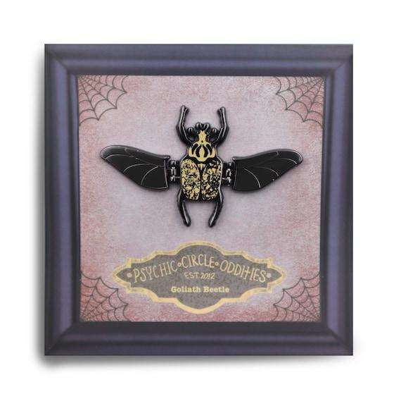 Moving wing- Goliath beetle enamel pin