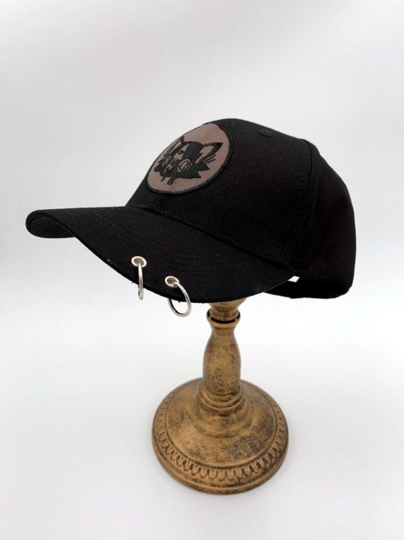 0df6ab561b97c Kitty kat piercing black baseball hat Art by lolimoog