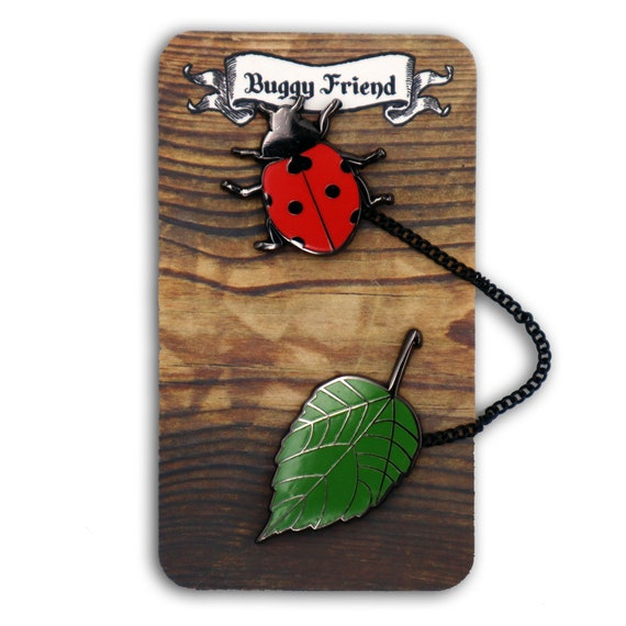 Chained lady bug and leaf enamel pin set! Buggy friend!