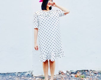 Polka dot ruffle edge dress