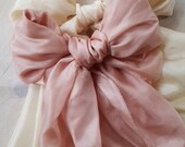 Sumptuous tied silk bow. ...