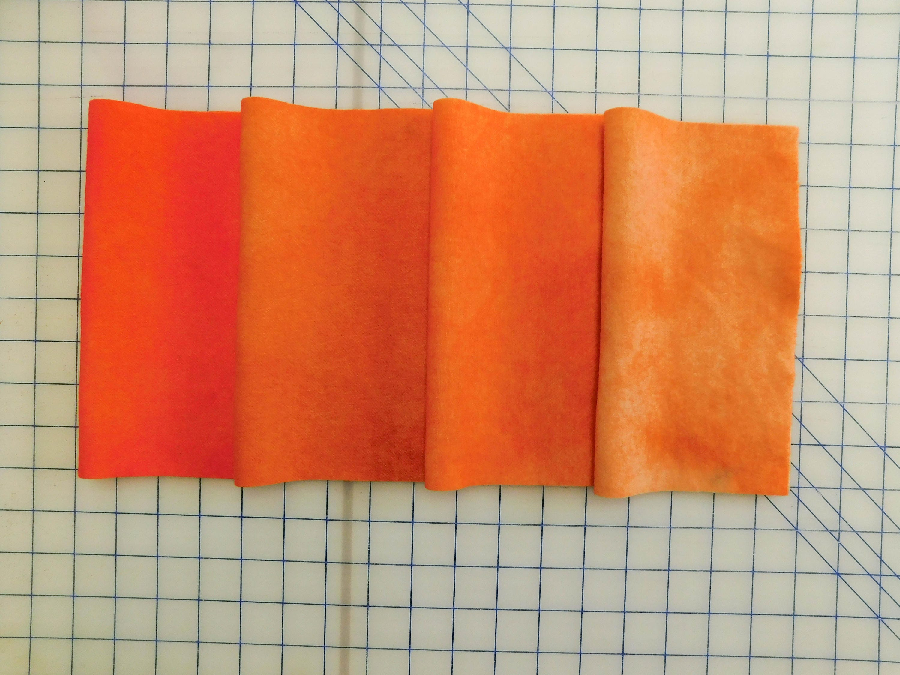 Four shades of mottled orange applique wool four shades of orange