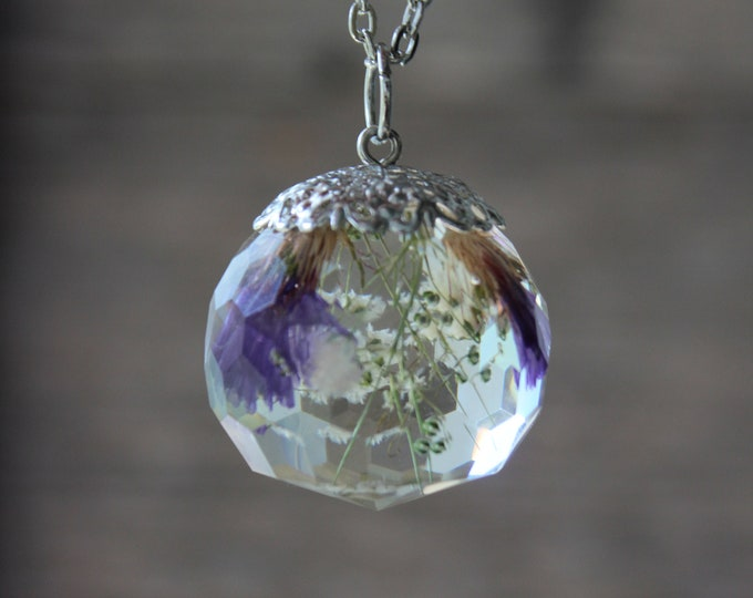 Crystal with real blue and white flowers