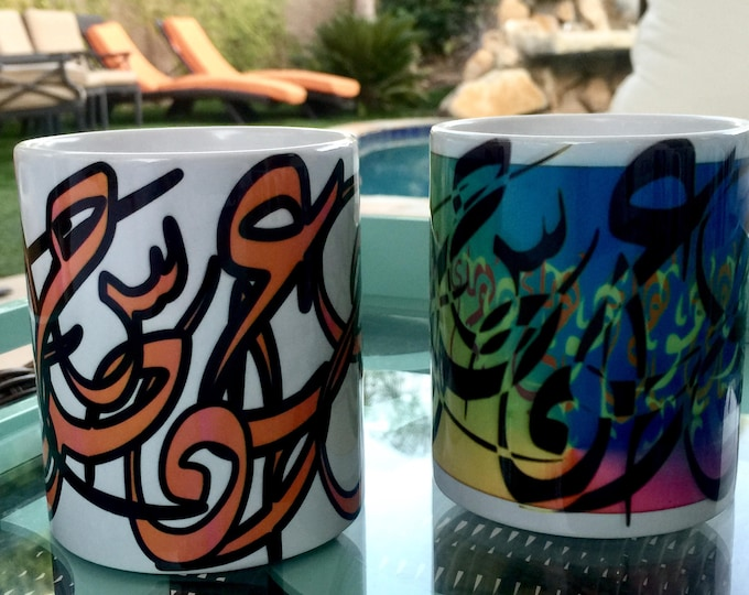 Set of two mugs orannge and multi color, With calligraphy graffiti design on it. Can be customized and made to order in any color