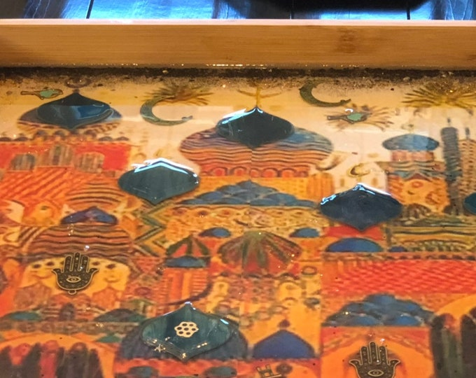large colorful rectangular wooden tray! Decorated over a printed art! Using resin, glass tile, metal charms. Hamsa, crescent ....