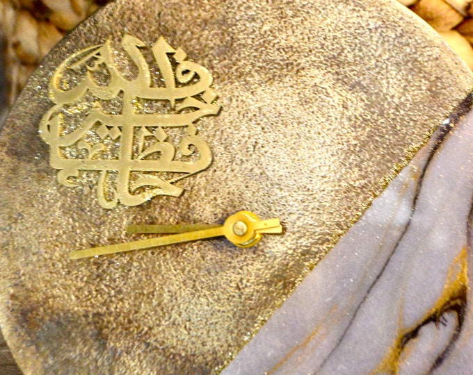 """Table clock..8"""" diameter...Cast Iron gold..3d calligraphy design..availabe in 2 designs"""