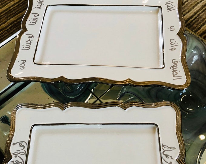 Set of three whote and silver serving plates decorated with Araboc calligraphy poetry