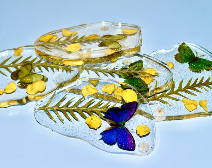 Six Clear resin coaster...dried flowers and a butterfly design