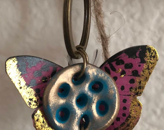 Keychain, bronze patina color. Seven eyes charm and 3d butterfly