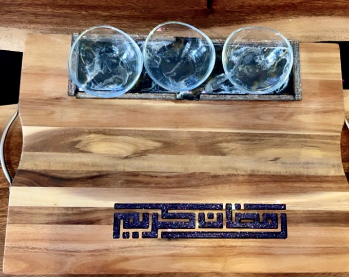 Ramadan Acacia wood serving platter with engraved glitter writings.. Arabic calligraphy رمضان كريم and three glass bowls ..