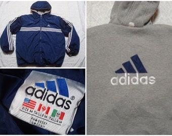 343e7e607630 Vintage Men s 90 s Adidas Jacket Reversible Blue Grey Three Stripes Logo  Spell Out Full Zip Windbreaker Hoodie Jacket Oversized Medium