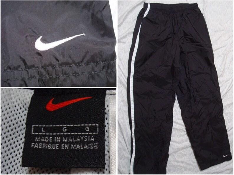 c630c83adb4ea Vintage Men's 90's Nike Pants Black White Stripe Warmup Windbreaker Jogger  Swoosh Nylon Large