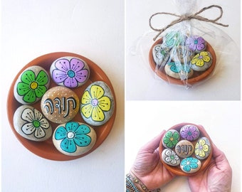 Special flower thank you gift made from 6 pebbles on Terracotta plate
