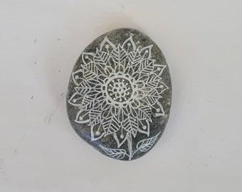 Flower design on stone, black and white